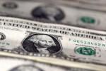 Dollar near three-week peak as global stimulus talk lifts yields