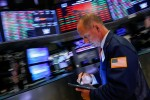 Wall St. falls after disappointing data, Fed policymakers dampen rate cut hopes