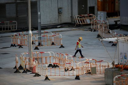 Battered Hong Kong faces economic recession, existential crisis
