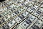 Dólar cai 1% na abertura com exterior positivo após dados na China e na Alemanha