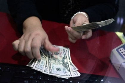 Virus spread beyond China spurs new round of dollar buying