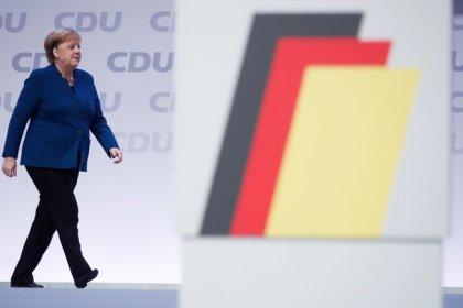 Hammered in Hamburg, Merkel's party meets on leadership crisis
