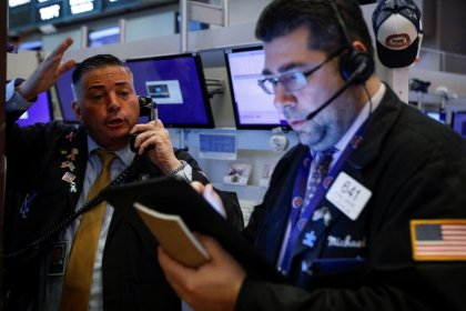 Stocks, oil tumble; gold spikes as virus fears grip markets