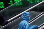 Global stock markets jump on Fed stimulus, oil pulls back from earlier surge