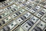 Dólar cai ante real com estímulos e Fed no radar