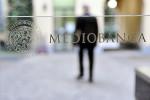 Mediobanca, utile giù 27% per impatto Covid, conferma target piano