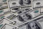 Dólar avança contra real após decisão tributária de Bolsonaro; BC faz leilão à vista