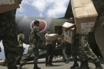 Aid rolls into Indonesia disaster city as more victims found
