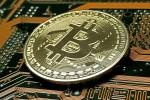 Bitcoin: crolla sotto 6.000 dlr, -13%