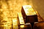 Vàng thế giới rút khỏi đỉnh 1 tuần khi đồng USD phục hồi