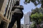 India Stocks Erase Gains as RBI Cuts Rates By Expected Amount