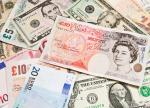 Forex- Dollar Falls to Four-Month Low as Euro, Sterling Surge