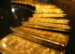 PRECIOUS-Gold rises as dollar backs off highs after Fed meeting minutes