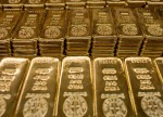 CORRECTED-PRECIOUS-Gold firm as technical gains give support against strong dollar (Oct 18)