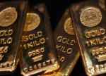 PRECIOUS-Gold firm on fragile risk-sentiment, buoyant dollar caps gains