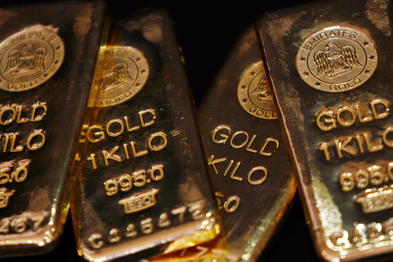 Gold slides as dollar jumps