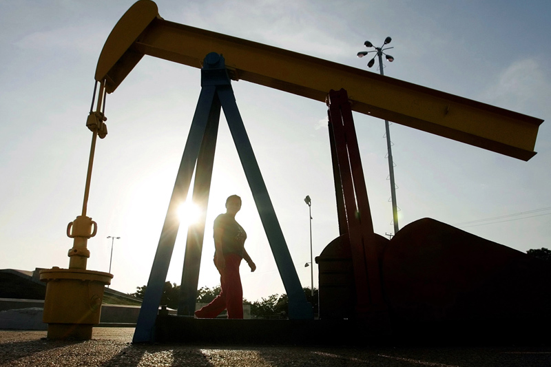 Oil prices edged down on Monday morning in Asia