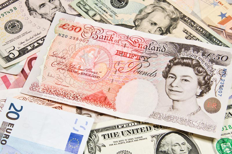 Sterling hits session lows after BoE inflation report damps rate hike expectations