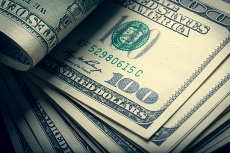 Dollar Strengthens; Helped by Housing Data and Fed Comments