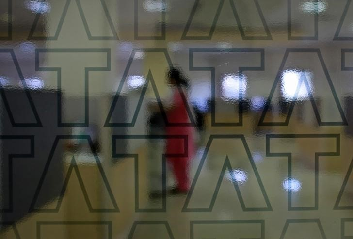 © Reuters. An employee of Tata Consultancy Services (TCS) works inside the company headquarters in Mumbai