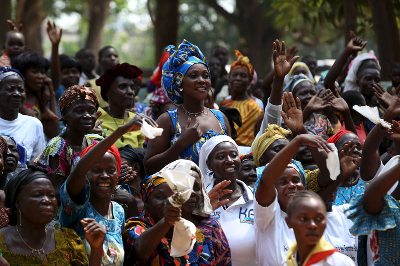 Under tight security pope urges peace in central africa by reuters internally displaced people sheltering on the grounds of the saint sauveur church greet m4hsunfo