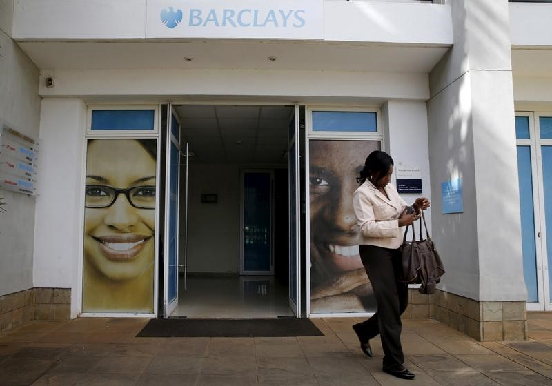 © Reuters. A woman walks from a banking hall within the Barclays Bank Kenya head offices in the capital Nairobi