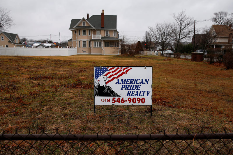 © Reuters. A real estate sign is seen behind a fence by an empty lot in Freeport, New York