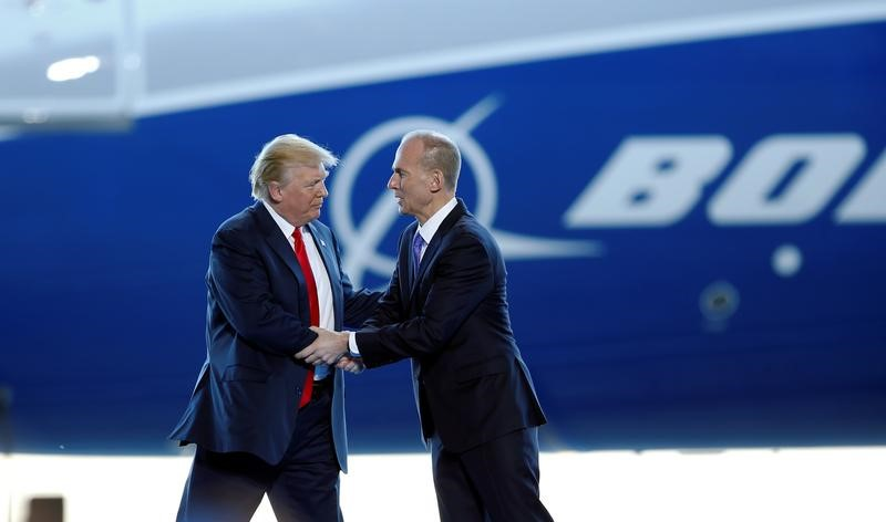 © Reuters. President Donald Trump greets Boeing Chairman, President and CEO Muilenburg during a ceremony celebrating the rollout of the Boeing 787-10 Dreamliner in North Charleston