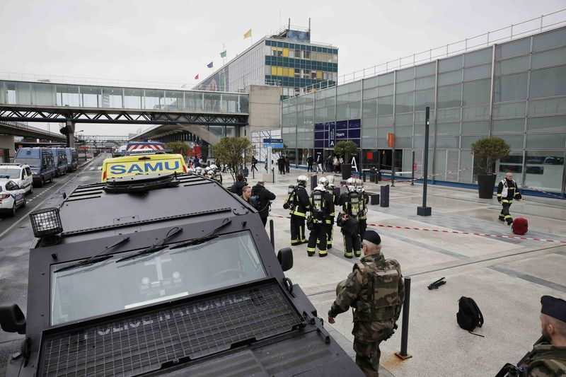 Militarу and emergencу services outside Orlу airport southern terminal after shooting incident near Paris