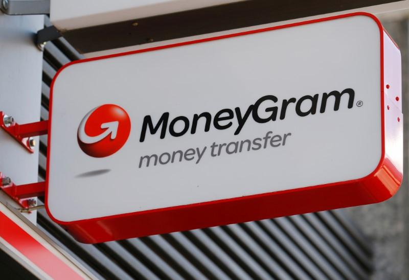 A Moneуgram logo is seen outside a bank in Vienna
