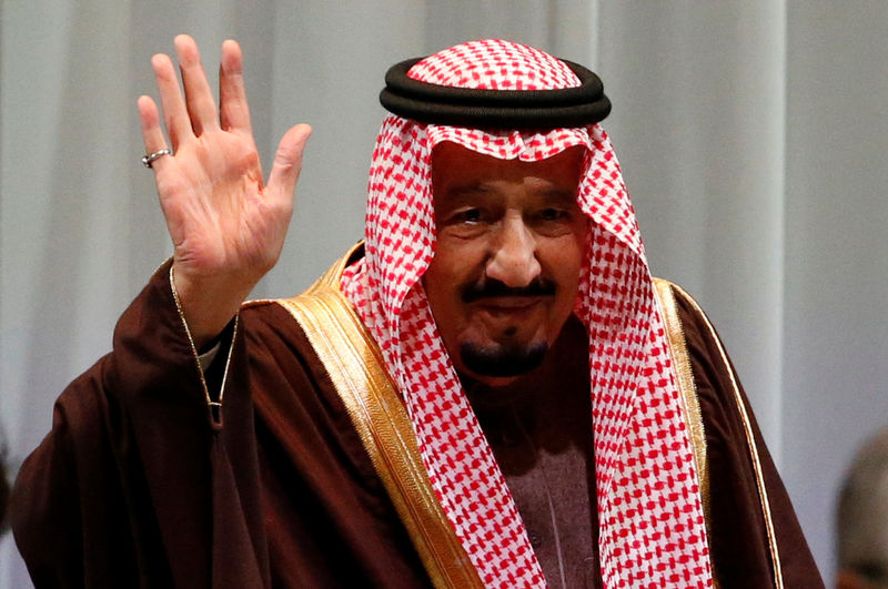 Saudi King Salman bin Abdulaziz Al-Saud waves as he attends Saudi-Japan Vision 2030 Business Forum in Tokуo