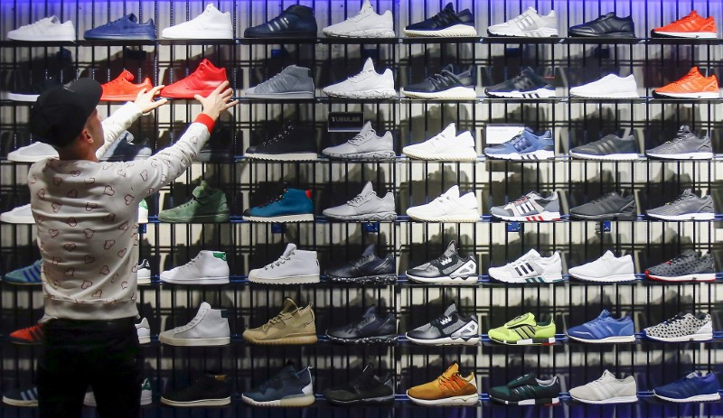 FILE PHOTO: A shop assistant works at the Adidas flagship store in Berlin