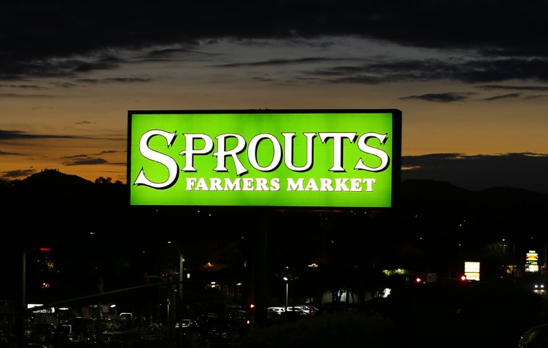 A billboard advertisement for Sprouts Farmers Market, a health food chain store, is shown in Encinitas, California
