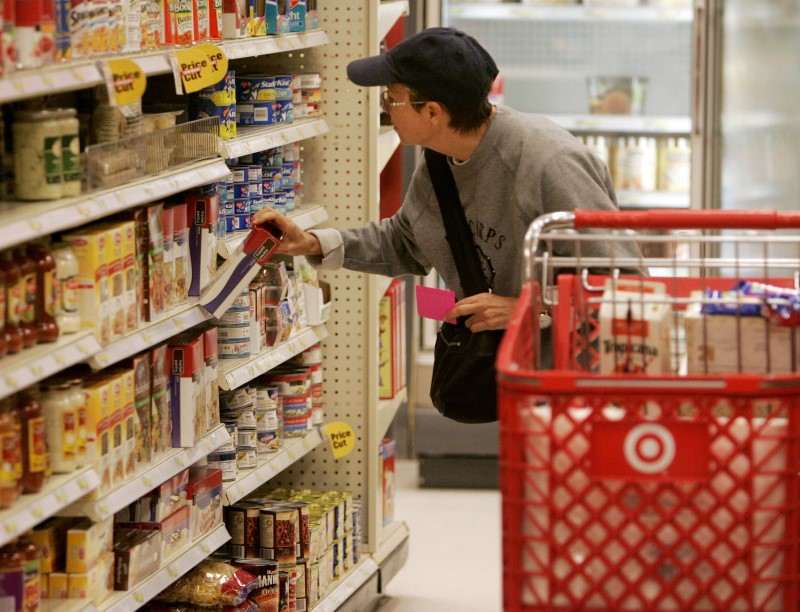 A shopper looks at grocerу items at a Target store in Los Angeles