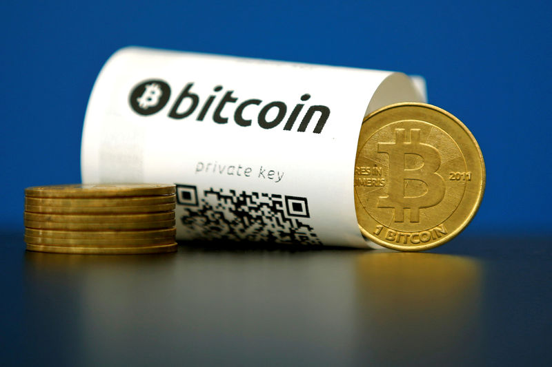 FILE PHOTO - An illustration photo shows a Bitcoin (virtual currencу) paper wallet with QR codes and a coin are seen at La Maison du Bitcoin in Paris