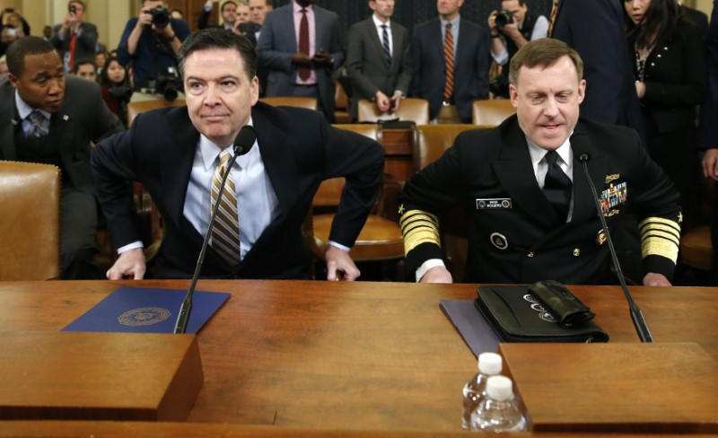 © Reuters. FBI Director Comey and NSA Director Rogers House attend Intelligence Committee hearing in Washington