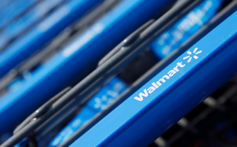 © Reuters. Shopping carts are seen outside a new Wal-Mart Express store in Chicago