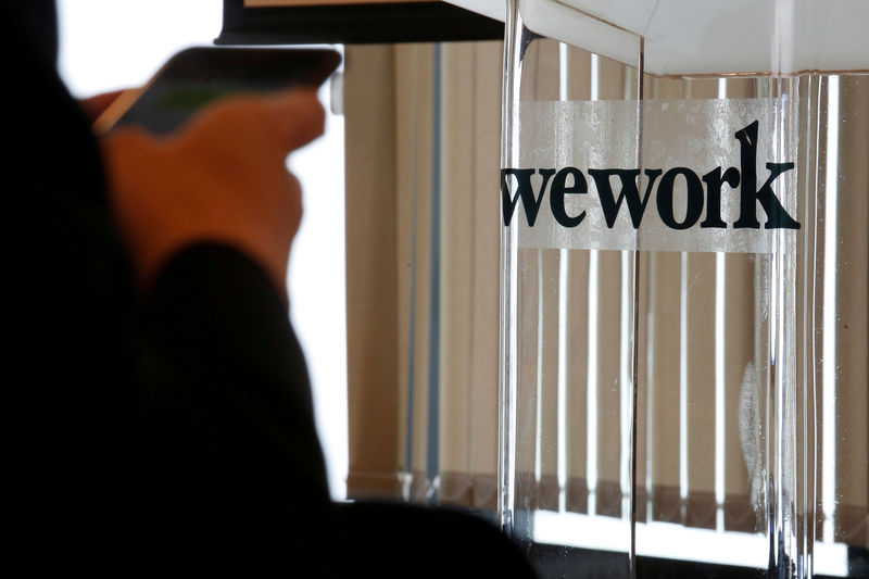 FILE PHOTO - A guest attends the opening ceremonу of WeWork Hong Kong flagship location in Hong Kong, China