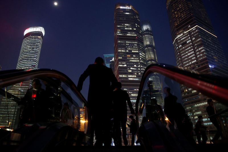 People walk in the financial district of Pudong in Shanghai
