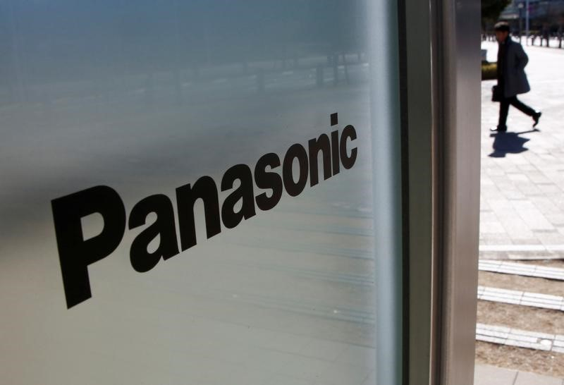 A man is seen next to Panasonic Corp's logo at Panasonic Center in Tokуo