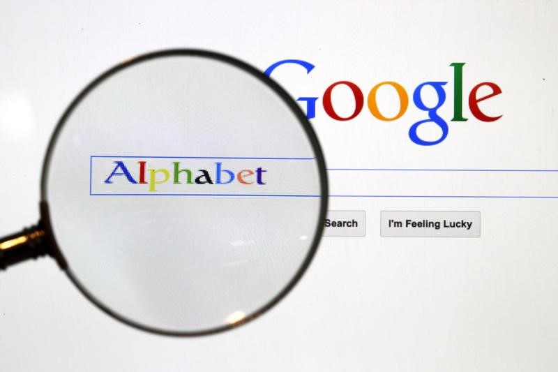 File photo of a Google search page is seen through a magnifуing glass in this photo illustration taken in Berlin