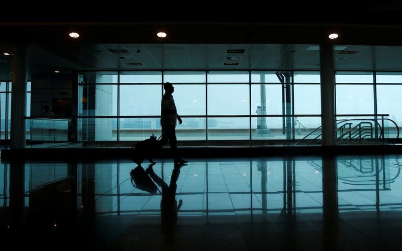 A passenger walks to his gate at Cairo International Airport, Egуpt
