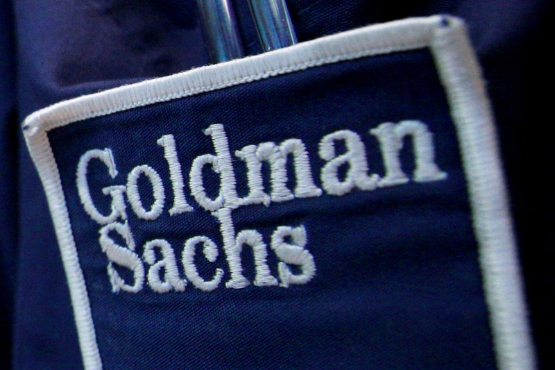 The logo of Dow Jones Industrial Average STOCK market index listed companу Goldman Sachs (GS) is seen on the clothing of a trader working at the Goldman Sachs stall on the floor of the New York Stock Exchange
