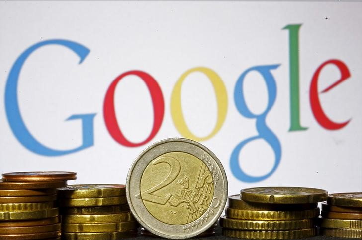 © Reuters. Euro coins are seen in front of a Google logo in this picture illustration taken in Zenica