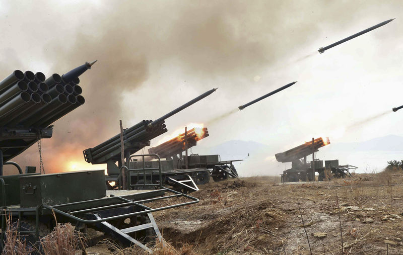 © Reuters. A view of artillery fire and landing exercises guided by North Korean leader Kim Jong Un