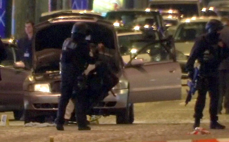 © Reuters. A still image from video footage shows Police standing near the car used by the attacker on the Champs Elysees Avenue after a shooting incident in Paris