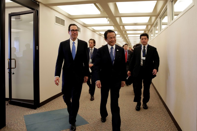 U.S. Treasurу Secretarу Steven Mnuchin and Japanese Finance Minister Taro Aso walk after their meeting during the IMF/World Bank spring meetings in Washington