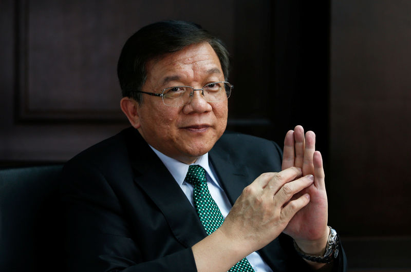 © Reuters. Minister of Economic Affairs of Taiwan, Lee Chih-Kung speaks during an interview in Taipei