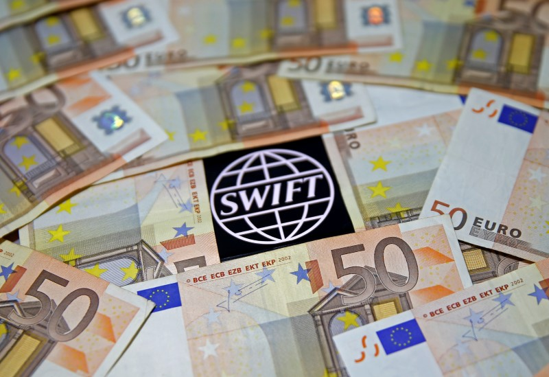 © Reuters. FILE PHOTO: Swift code bank logo is displayed on an iPhone 6s among Euro banknotes in this picture illustration