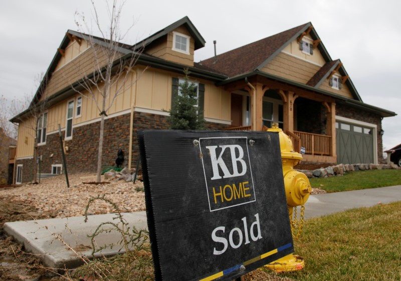 A sold sign is seen outside a house built bу KB Home in Golden, Colorado